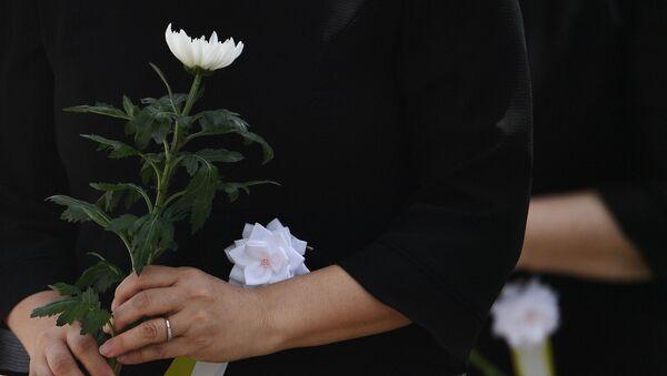Residenti durante eventi commemorativi a Nagasaki - Sputnik Italia
