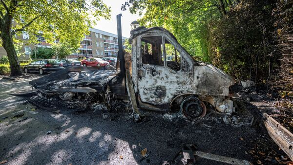 A burnt out light truck is seen in Rosengard after Friday's night of riots, in Malmo, Sweden August 29, 2020 - Sputnik Italia