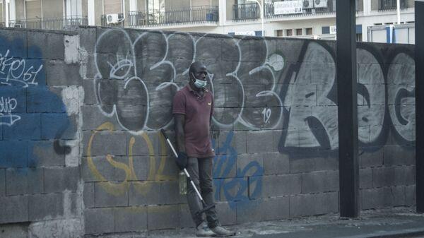 Un migrante in Italia - Sputnik Italia