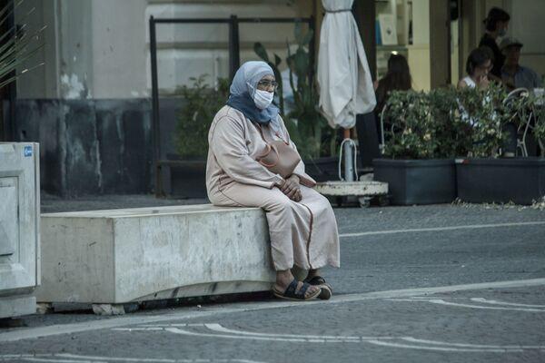 Una migrante in Italia - Sputnik Italia
