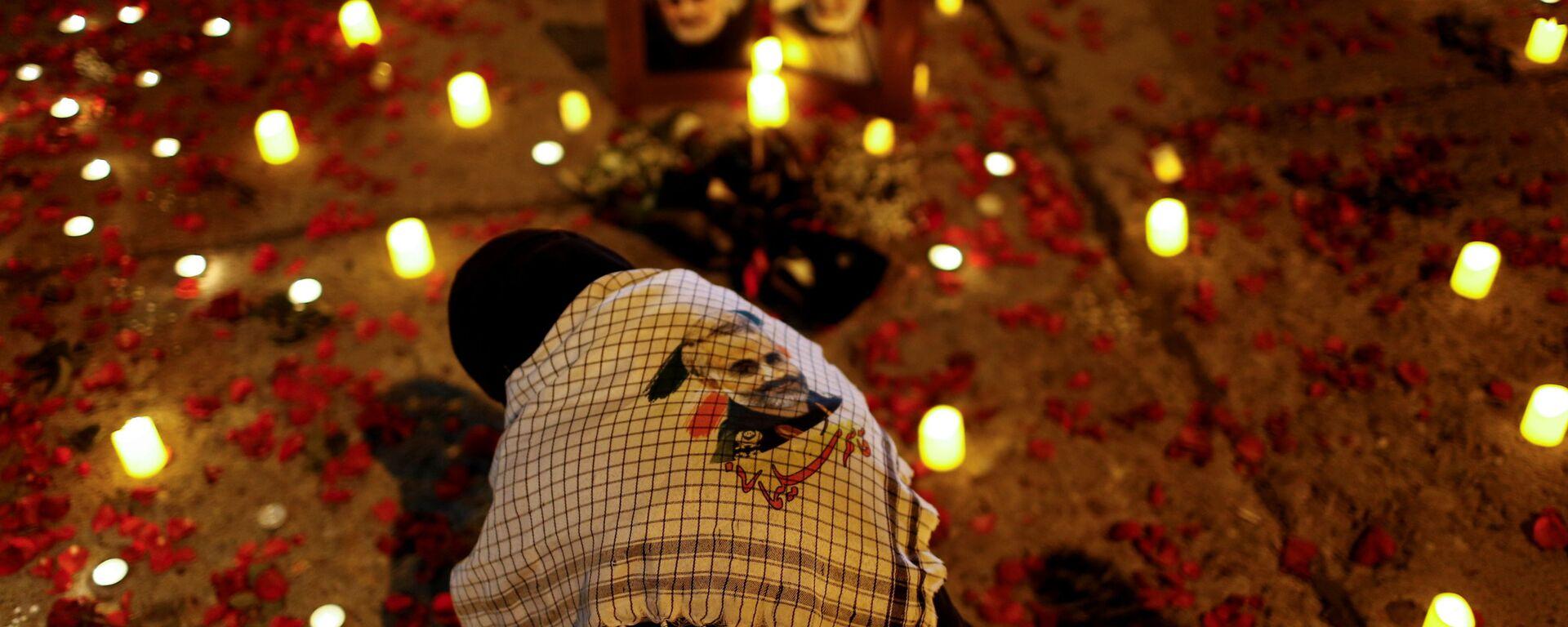 Una donna nel primo anniversario della morte del comandante iraniano Qasem Soleimani e del comandante iracheno Abu Mahdi al-Muhandis a Baghdad - Sputnik Italia, 1920, 05.01.2021