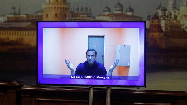 Russian opposition leader Alexei Navalny is seen on a screen via a video link during a court hearing to consider an appeal on his arrest outside Moscow, Russia January 28, 2021 - Sputnik Italia