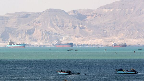 Ships and boats are seen at the entrance of Suez Canal, which was blocked by stranded container ship Ever Given that ran aground, Egypt March 28, 2021. REUTERS/Mohamed Abd El Ghany - Sputnik Italia