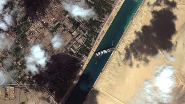 A general view of the Ever Given container ship in Suez Canal, in Suez Canal in this Maxar Technologies satellite image taken on March 27, 2021.  - Sputnik Italia