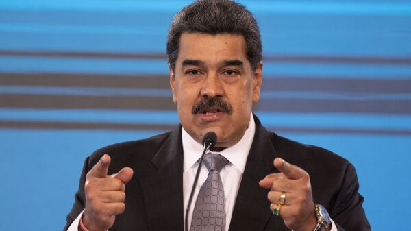 Conferenza stampa del Presidente venezuelano Nicolas Maduro al palazzo presidenziale Miraflores di Caracas, 17 febbraio 2021 - Sputnik Italia