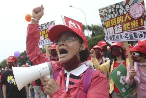 I lavoratori taiwanesi partecipano a una manifestazione in occasione della Giornata internazionale del Lavoro a Taipei, Taiwan - Sputnik Italia