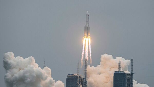 A Long March 5B rocket, carrying China's Tianhe space station core module, lifts off from the Wenchang Space Launch Center in southern China's Hainan province on April 29, 2021.  - Sputnik Italia