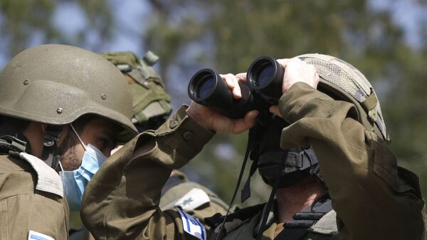 This picture taken on 9 March 2021, near the northern Israeli kibbutz of Misgav Am, shows Israeli forces watching the blue line, a demarcation line drawn by the United Nations to mark Israel's withdrawal from southern Lebanon in 2000.  - Sputnik Italia
