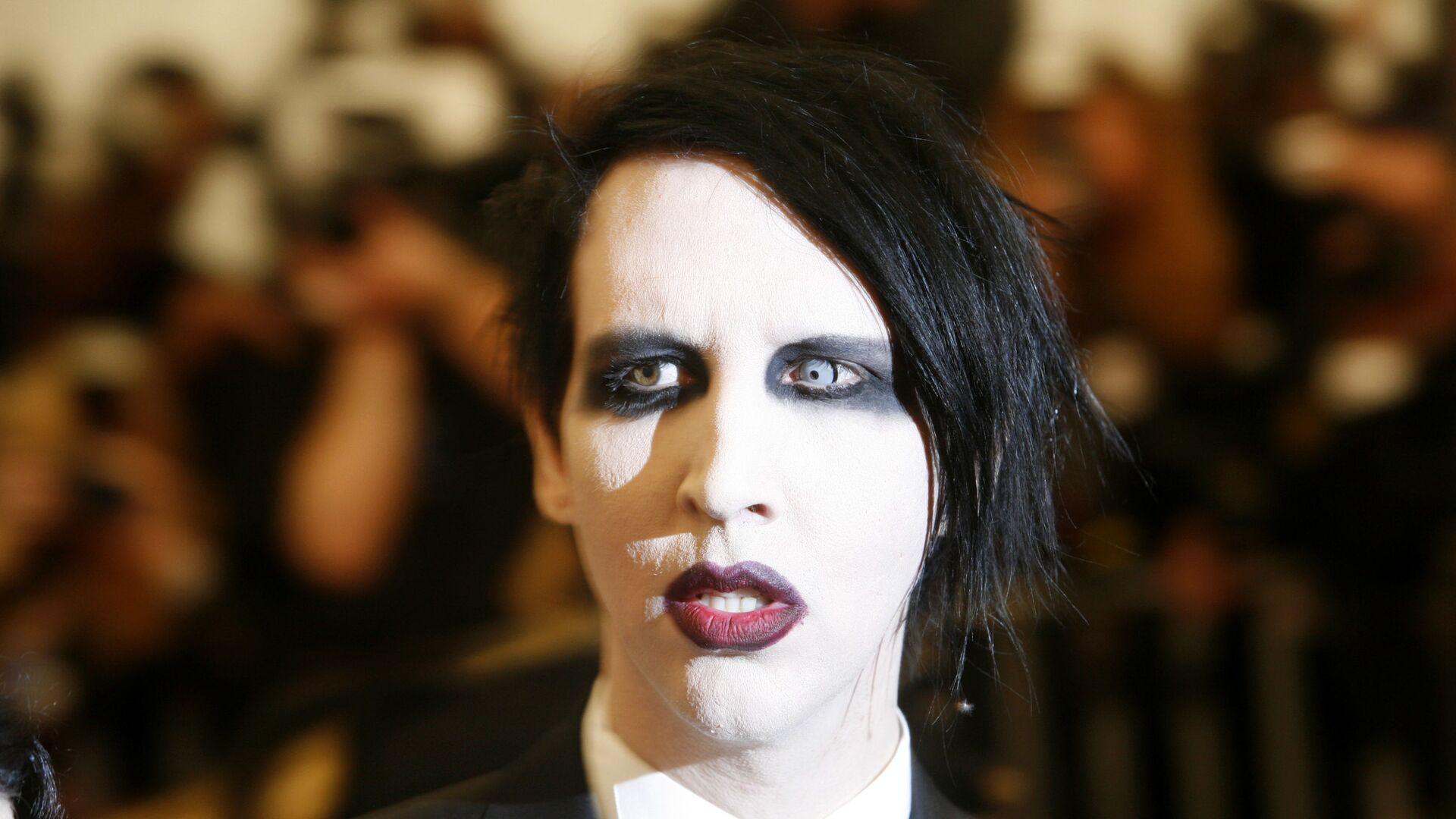 Marilyn Manson, pseudonimo di Brian Hugh Warner, un cantautore, produttore discografico, attore e pittore statunitense - Sputnik Italia, 1920, 26.05.2021