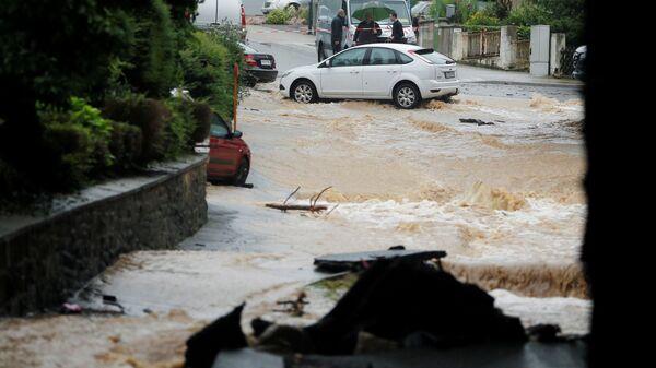 Затопленная улица после проливных дождей в Хагене, Германия  - Sputnik Italia