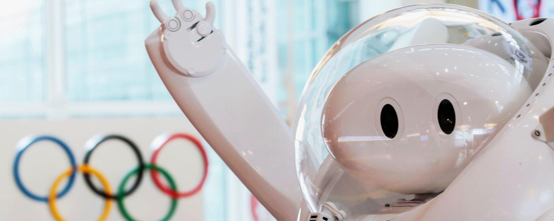 Робот у информационной стойки в аэропорту Haneda  - Sputnik Italia, 1920, 24.07.2021