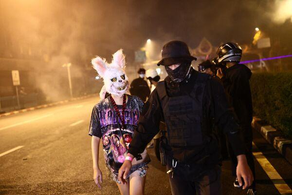 I protestanti durante una manifestazione antigovernativa chiedono le dimissioni del governo per la gestione della crisi del Covid-19, Bangkok, Thailandia, il 19 settembre 2021. - Sputnik Italia