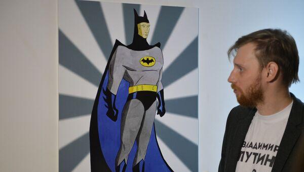 Il ritratto del presidente russo Vladimir Putin con il volto di Batman alla mostra Universo di Putin a Mosca. - Sputnik Italia