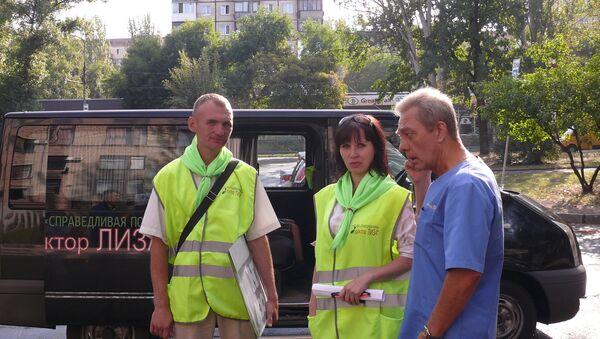 Andrey con i suoi collaboratori - Sputnik Italia