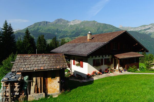 Una casa a Wengen, un paese svizzero, nel Canton Berna. - Sputnik Italia