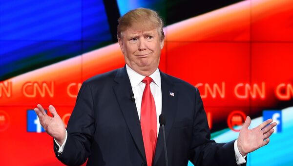 Republican presidential candidate businessman Donald Trump gestures during the Republican Presidential Debate, hosted by CNN, at The Venetian Las Vegas on December 15, 2015 in Las Vegas, Nevada. - Sputnik Italia