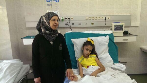 Sidra Zaarour, originaria di Aleppo, ha perso le gambe a seguito di un bombardamento da parte dei terroristi - Sputnik Italia