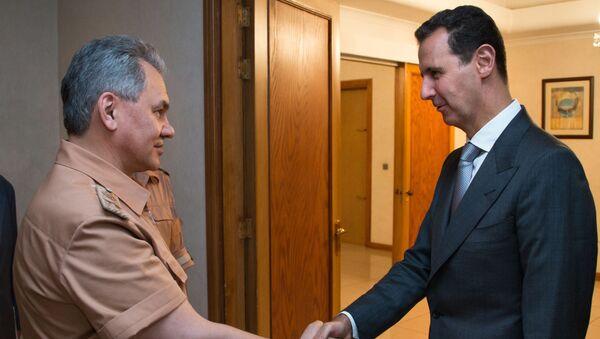 Incontro tra ministro della Difesa russo Sergey Shoigu e presidente siriano Bashar Assad - Sputnik Italia