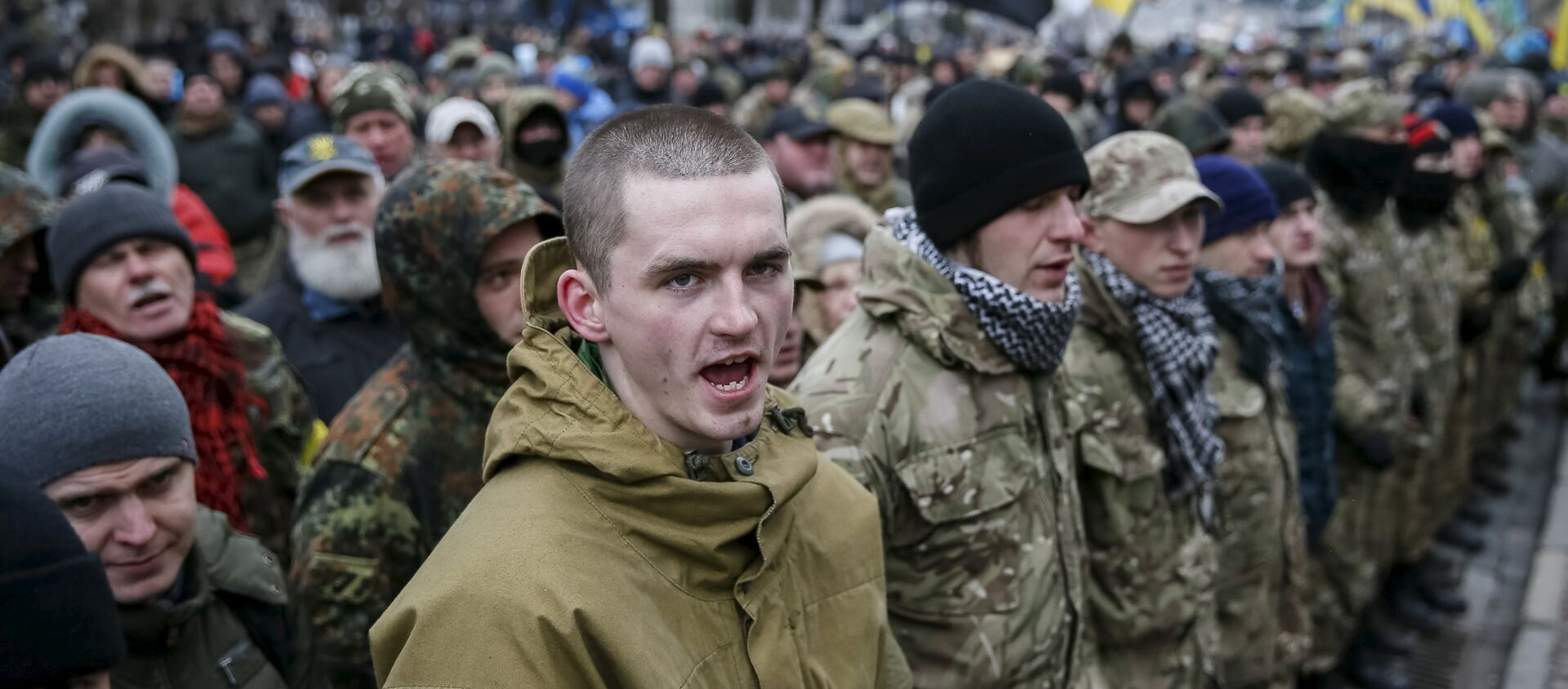 Members of self-defence battalions take part in a rally to commemorate demonstrators who were killed during the Maidan protests in 2014 in Kiev, Ukraine, February 20, 2016 - Sputnik Italia, 1920, 28.12.2016