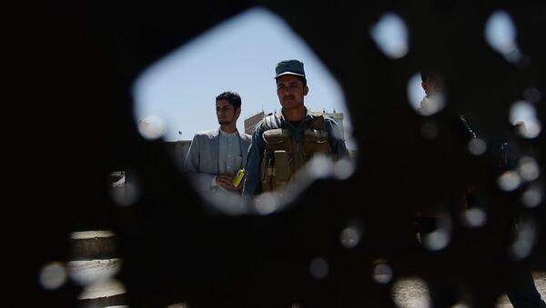 Афганская полиция на месте взрыва в Кабуле. Архивное фото - Sputnik Italia