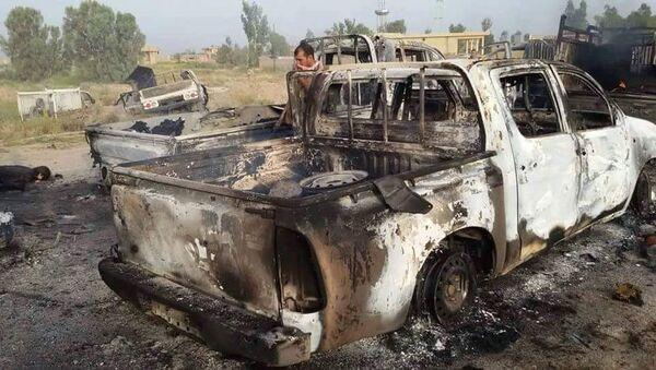 Veicolo distrutto dopo raid della coalizione USA in Iraq - Sputnik Italia