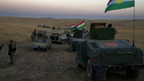 A Peshmerga convoy drives towards a frontline in Khazer, about 30 kilometers (19 miles) east of Mosul, Iraq, Monday, Oct. 17, 2016 - Sputnik Italia