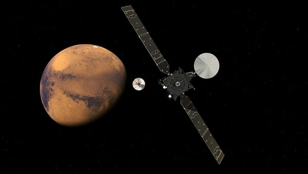 The ExoMars Trace Gas Orbiter and its entry, descent and landing demonstrator module, Schiaparelli, approaching Mars. - Sputnik Italia