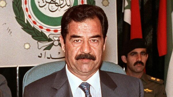 Iraqi President Saddam Hussein shown in file picture dated 28 May 1990 in Baghdad, addresses the opening session of the Extraordinary Arab Summit called to adopt a unified Arab stance against Soviet Jewish immigration to Israel.(File) - Sputnik Italia