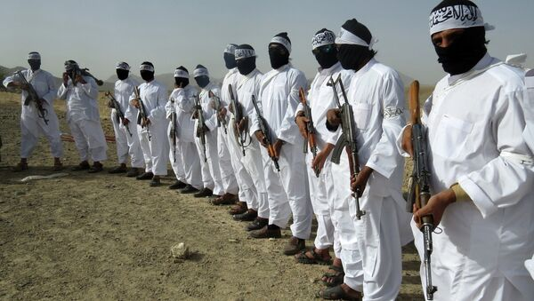 File, In this Aug. 15, 2016 photo, Taliban suicide bombers stand guard during a gathering of a breakaway Taliban faction, in the border area of Zabul province, Afghanistan - Sputnik Italia
