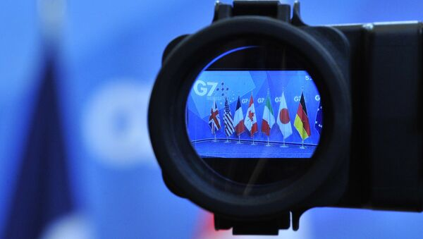 Flags are seen in a camera screen at the G7 summit (file) - Sputnik Italia