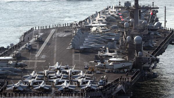 U.S. aircraft carrier USS Carl Vinson arrives for an annual joint military exercise called Foal Eagle between South Korea and U.S, at the port of Busan, South Korea, March 15, 2017. - Sputnik Italia