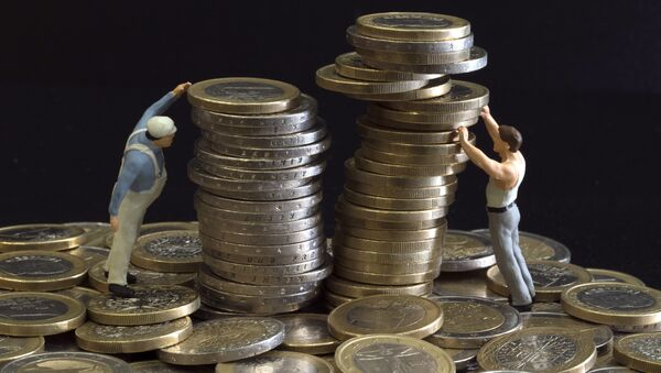 Picture taken on July 26, 2012 in Paris shows an illustration made with figurines and euro coins - Sputnik Italia