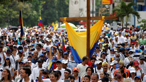 Manifestazione per commemorare le vittime delle violenze tenutesi durante proteste contro il presidente venezuelano Nicolas Maduro - Sputnik Italia