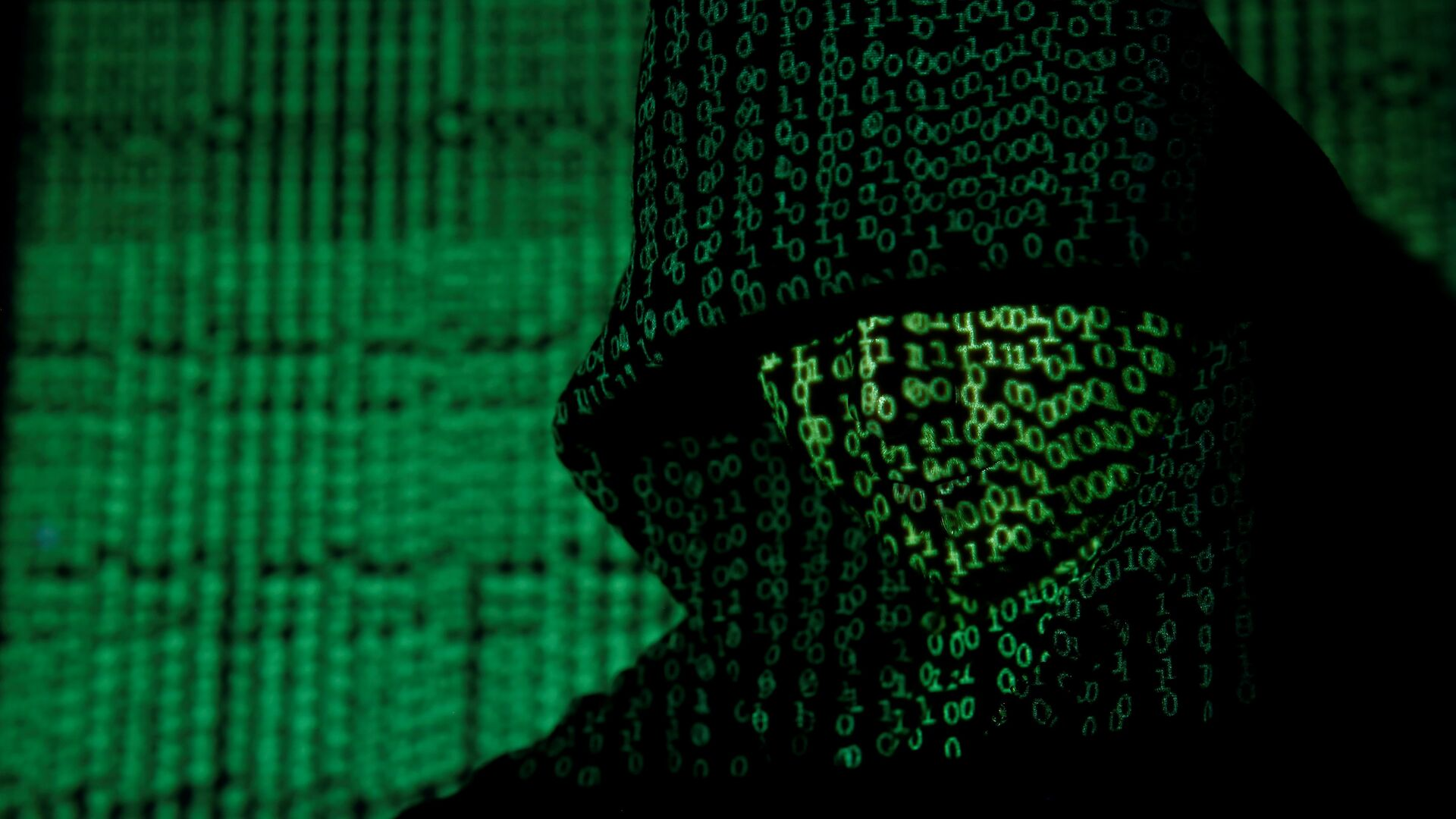 A projection of cyber code on a hooded man is pictured in this illustration picture taken on May 13, 2017 - Sputnik Italia, 1920, 14.10.2021
