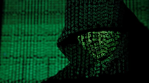 A projection of cyber code on a hooded man is pictured in this illustration picture taken on May 13, 2017 - Sputnik Italia