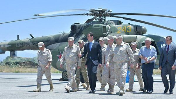Syria's President Bashar al-Assad visits a Russian air base at Hmeymim, in western Syria in this handout picture posted on SANA on June 27, 2017, Syria. - Sputnik Italia