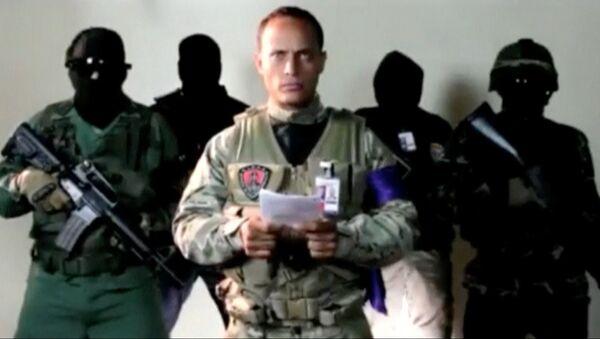Офицер Оскар Перес во время видеобращения - Sputnik Italia