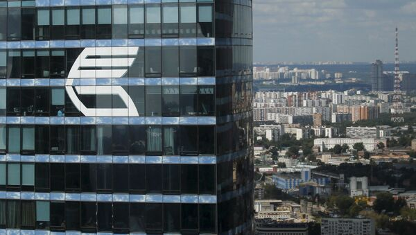 The logo of VTB Group is seen through a window of Imperia Tower on the facade of the Federatsiya (Federation) Tower at the Moscow International Business Center also known as Moskva-City, in Moscow, Russia, in this August 5, 2015 file photo - Sputnik Italia