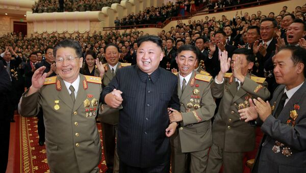 North Korean leader Kim Jong Un reacts during a celebration for nuclear scientists and engineers who contributed to a hydrogen bomb test, in this undated photo released by North Korea's Korean Central News Agency (KCNA) in Pyongyang on September 10, 2017 - Sputnik Italia