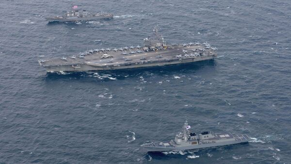 The Navy's forward-deployed aircraft carrier USS Ronald Reagan and the forward-deployed Arleigh Burke-class destroyer USS Stethem steam alongside ships from the Republic of Korea Navy in the waters east of the Korean Peninsula on October 18, 2017 - Sputnik Italia