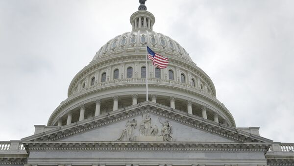 In this May 4, 2017, file photo, the U.S. flag flies in front of the Capitol dome on Capitol Hill in Washington - Sputnik Italia