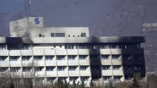 Afghan security personnel are seen at the roof of Intercontinental Hotel after an attack in Kabul, Afghanistan, Sunday, Jan. 21, 2018. Gunmen stormed the hotel and sett off a 12-hour gun battle with security forces that continued into Sunday morning, as frantic guests tried to escape from fourth and fifth-floor windows - Sputnik Italia