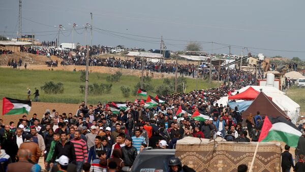 Palestinians attend a tent city protest along the Israel border with Gaza, demanding the right to return to their homeland, east of Gaza City - Sputnik Italia