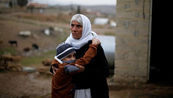 Ayman, a boy from a minority Yazidi community, who was sold by Islamic State militants to a Muslim couple in Mosul, hugs his grandmother after he was returned to his Yazidi family, in Duhok, Iraq, January 31, 2017 - Sputnik Italia