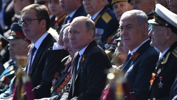 Il presidente russo Putin alla Parata del Giorno della Vittoria 2018 - Sputnik Italia