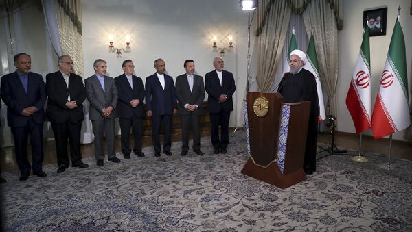 Il presidente iraniano Hassan Rouhani interviene per la TV - Sputnik Italia