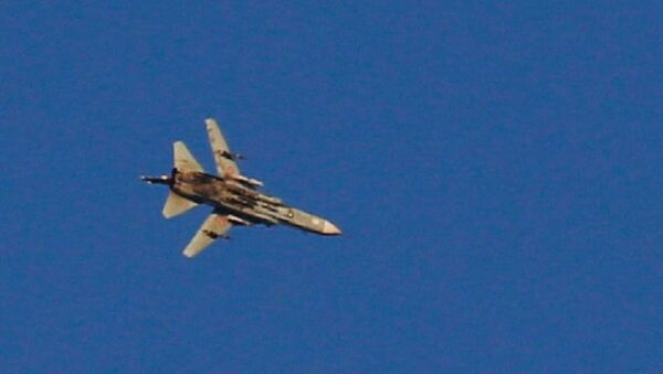 A war jet flies above Syria near the Israeli Syrian border as it is seen from the Israeli-occupied Golan Heights, Israel July 23, 2018 - Sputnik Italia
