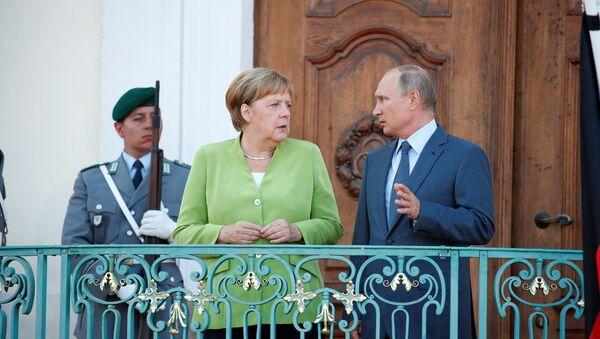 Angela Merkel e Vladimir Putin a Berlino, il 18 agosto del 2018 - Sputnik Italia