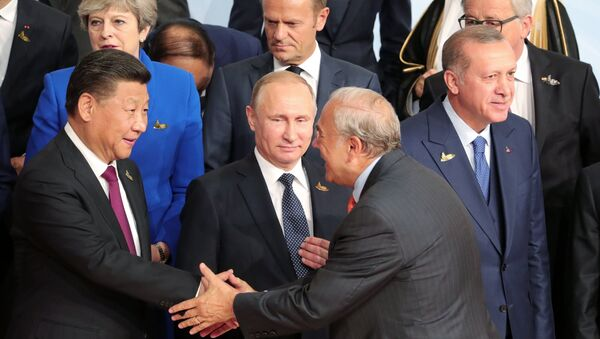 July 7, 2017. Russian President Vladimir Putin during a group photo session of the G20 heads of state, invited countries and international organizations in Hamburg. At left in the foreground: Chinese President Xi Jinping; right: President of Turkey Recep Tayyip Erdogan - Sputnik Italia