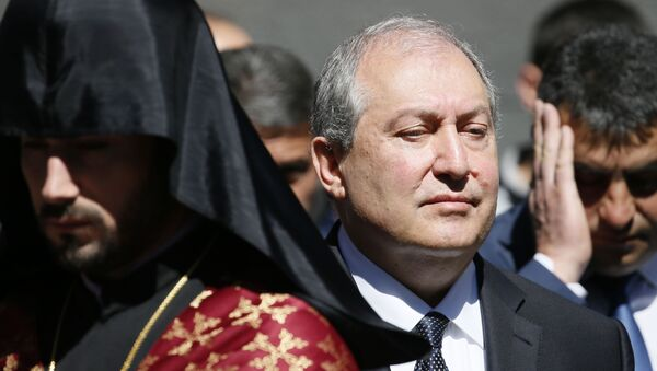Armenian President Armen Sarkissian attends a wreath laying ceremony to commemorate the 103rd anniversary of mass killing of Armenians by Ottoman Turks, at the Tsitsernakaberd Memorial Complex in Yerevan, Armenia April 24, 2018 - Sputnik Italia